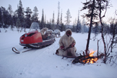 Olga Kirillova, a Sami woman from Lovozero, lights a fire during a break in a snowmobile journey. Murmansk, NW Russia. 2005