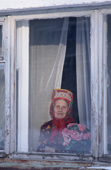 Maria Zakharova, an 82 year old Sami woman, at the window of her apartment in Lovozero. Murmansk, Kola Peninsula, NW Russia. 2005