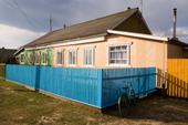 A brightly coloured wooden house in the village of Pogost. Ryazan Province, Russia. 2006