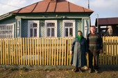 Mikhail Sobelev and his wife Alexandra outside their 100 year old home in Pogost. Ryazan Province, Russia. 2006