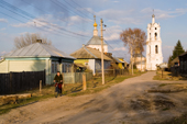 Street scene in the village of Pogost with the church of St. Nikolai in the background. Ryazan Province, Russia. 2006