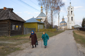 Elderly women returning home after an evening church service in the village of Pogost. Ryazan Province, Russia. 2006