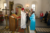 Priest, Nikolai Shvachka, conducting a wedding ceremony in the village Church of St. Nikolai in Pogost, Ryazan Province, Russia. 2006