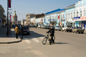 A cyclist crosses the main street in the town of Kasimov. Ryazan Province, Russia. 2006