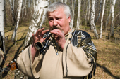 A musician from the Russian folk group The 'People's Festival.' Ryazan Province, Russia. 2006