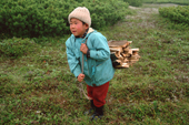 Tungus, a young Evenk boy, collecting firewood at a reindeer herders camp in Piltun Bay, Sakhalin Island, Russian Far East.