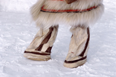 A Nganasan woman wearing traditional cylindrical shaped reindeer skin boots. Taymyr, Northern Siberia, Russia. 2004
