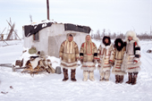 A group of Nganasan men and women in traditional dress outside a hut at a camp on the Kheta River. Taymyr, Northern Siberia, Russia. 2004