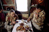 Two Nganasan men, Saibore Momde & Mereme Moibo (right) drinking tea together in a hut. Taymyr, Northern Siberia, Russia. 2004