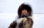 Nadiya Asyandu, a Nganasan woman, wramly dressed while travelling on the frozen Kheta River in the winter. Taymyr, Northern Siberia, Russia. 2004