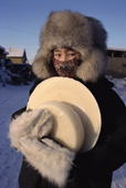 Lena Potapova carrying frozen milk back to her home in Verkhoyansk. Yakutia, Siberia, Russia.