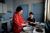 Lena Potapova helps her mother peel potatoes at home in Verkhoyansk. Yakutia, Siberia, Russia