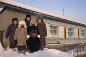 The Potapova family pose outside their home in Verkhoyansk. Yakutia, Siberia. Russia.