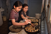 Lena Potapova and her sister Varya making Pishkij at their home in Verkhoyansk. Yakutia, Siberia, Russia