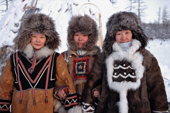 Three Evenk women dressed in traditional winter fur clothing. Kusur, Northern Yakutia, Siberia, Russia