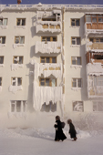An apartment block coated in ice and frost during the winter in Yakutsk. Yakutia, Siberia, Russia.