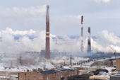 Smoke containing sulphur dioxide belches from the chimneys of a nickel foundry at Norilsk W.Siberia, Russia
