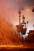 Sparks shower into the converter aisle at the copper foundry in Norilsk. Western Siberia, Russia.