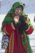 A Mansi woman wearing traditional dress using her mobile phone in Saranpaul. Khanty Mansiysk, Northwest Siberia, Russia