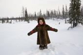 Yana Nogo, a 2 year old Komi girl, plays outside in the snow at her family's winter camp. Yamal, Northwest Siberia, Russia