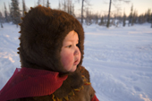 Yana Nogo, a 2 year old Komi girl, outside at her family's winter camp. Yamal, Northwest Siberia, Russia