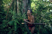 Bow & arrow at the ready Aman Baoi stalks a monkey. Siberut Island. Indonesia.