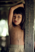 Mentawai girl watches from the door of the Uma. Siberut. Indonesia.
