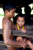 Young Mentawai man with young boy. Siberut Island, Indonesia.