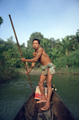 Mentawai man in his dugout canoe goes up to his village  Siberut Is. Indonesia.