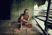 Mentawai medicine man making arrows to shoot monkeys. Siberut Island, Indonesia.