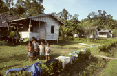 Young Mentawai children in front of a house, at the new government social village at Puro. Siberut Island, Indonesia