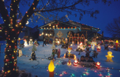 An elaborate display of illuminated christmas figures in a garden in Winnipeg. Manitoba. Canada. Canada.