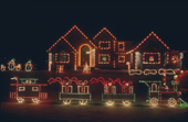 A private home and garden illuminated with Christmas lights in Winnipeg. Manitoba Canada.