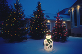 An illuminated snowman forms part of Christmas display  outside a home in Winnipeg. Manitoba. Canada Canada.