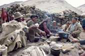 Yak herders cook a meal over an open fire at their camp. Ladakh, India