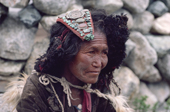 Woman Yak herder wears a head-dress of turquoise and other semi-precious stones. Nimaling Plateau. Ladakh. India.